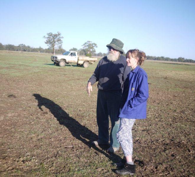 Heidi and Dan on the farm feeding the cattle